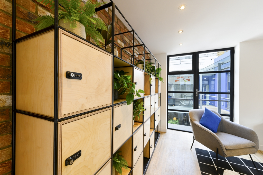 A wall of lockers and plants in the co-working space at Worlds End Studios.
