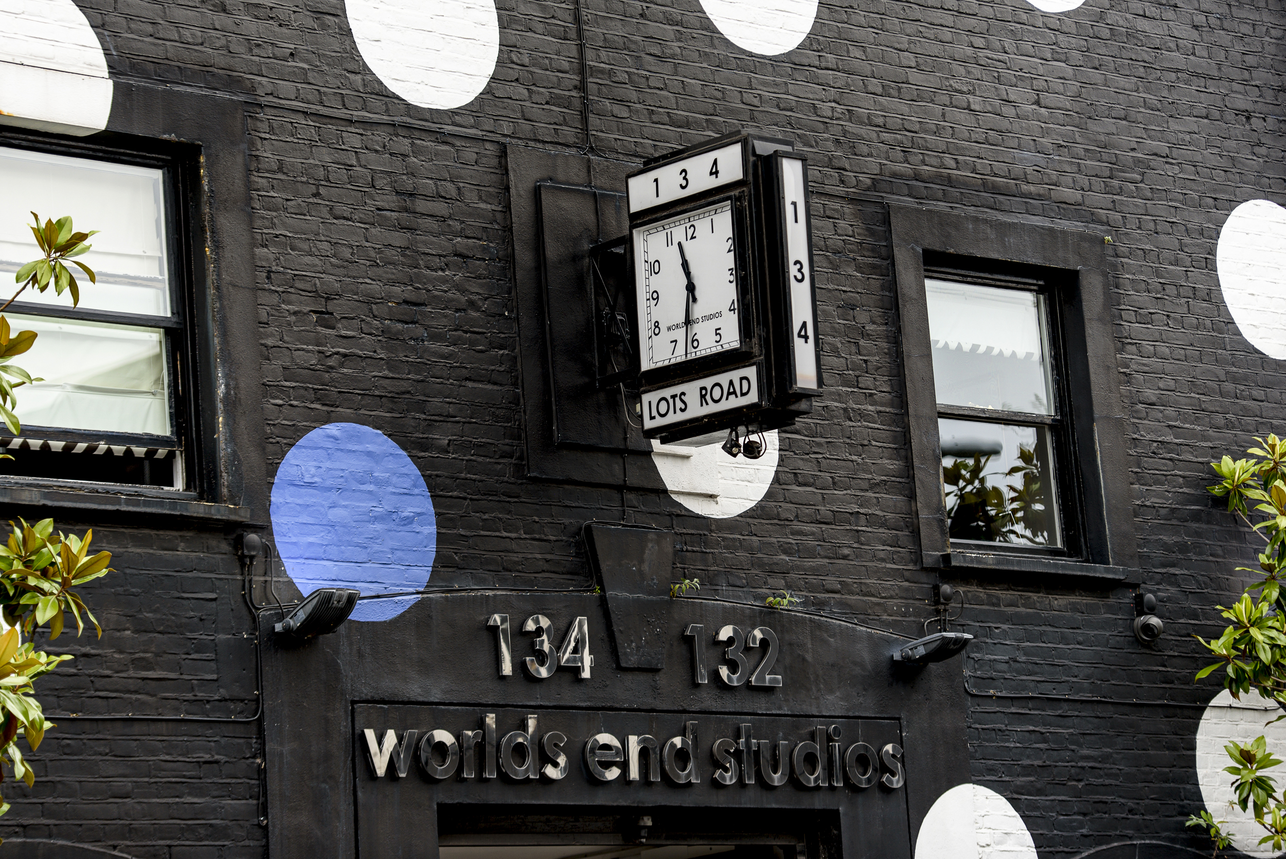 The front of Worlds End Studios on Lots Road painted in black and white polka dots
