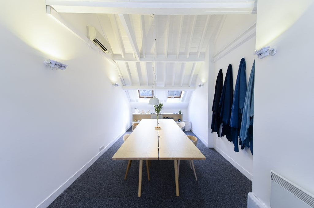 A spacious showroom or office space at Worlds End Studios showcasing lots of natural light.