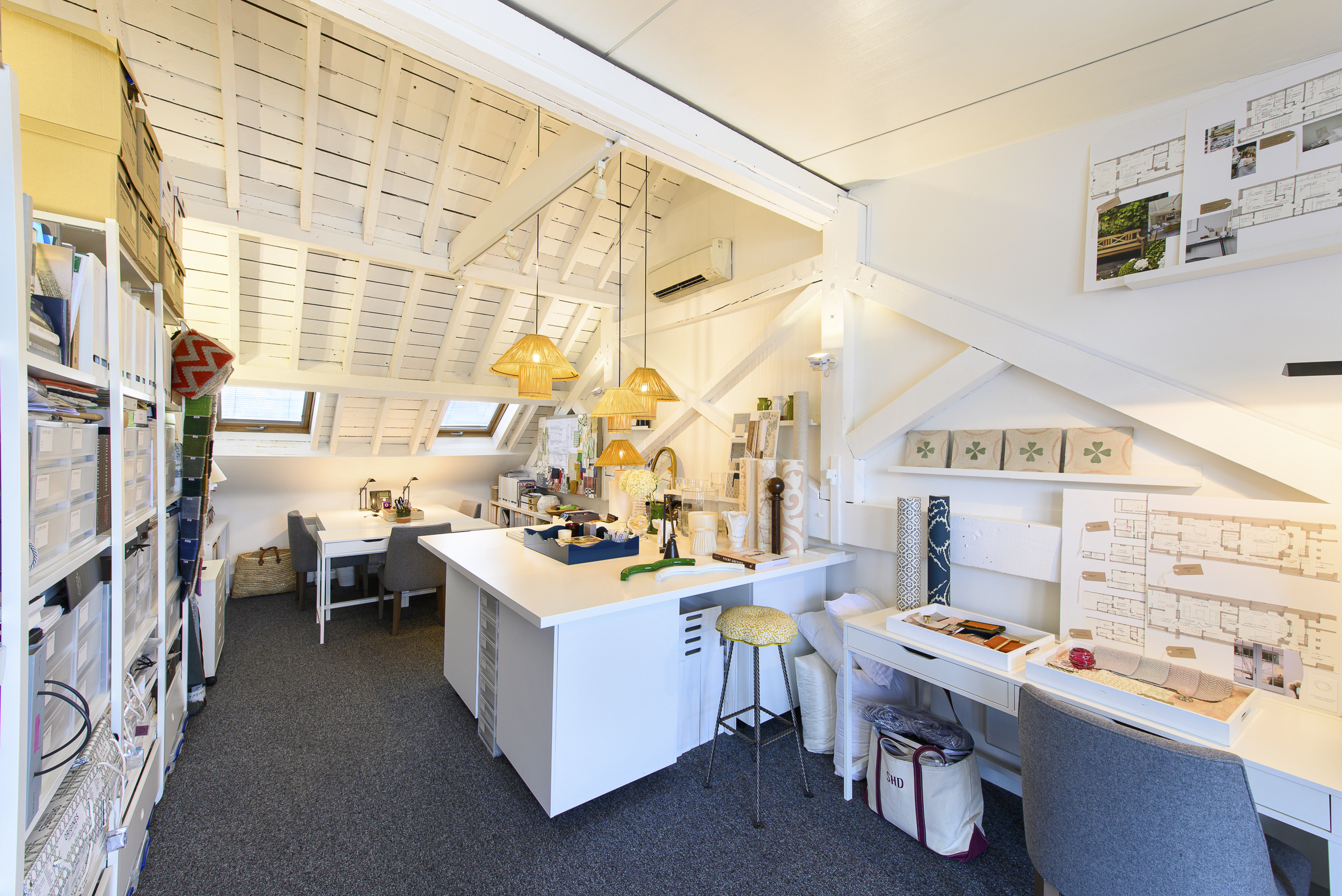 A bright an airy office space at Worlds End Studios featuring beams and a workspace.